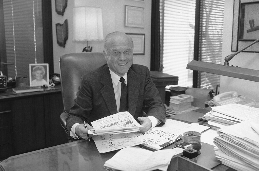 . Sen. John Glenn D-Ohio, poses for photographers in his Capital Hill office in Washington, March 15, 1984. Glenn has decided to end his once-promising bid for the Democratic presidential nomination after failing to win a single primary or caucus, sources said. (AP Photo/Ron Edmonds)