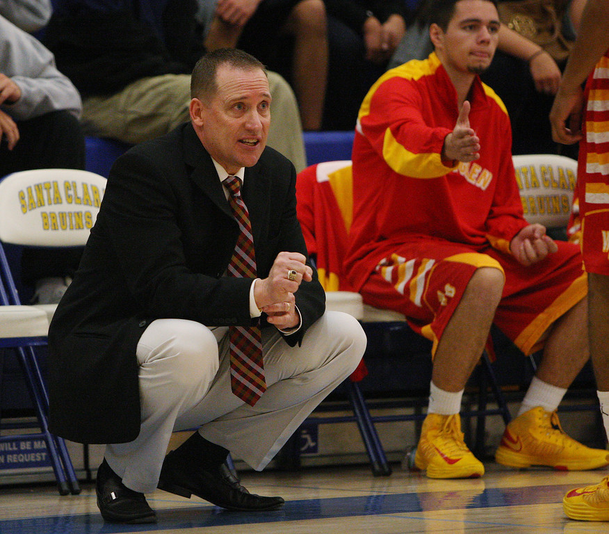 . Willow Glen coach Todd Meeker signals his players in the second quarter during the CCS Division II boys basketball finals at Santa Clara High School in Santa Clara, Calif. on Friday, March 1, 2013. The Saint Francis Lancers played the Willow Glen Rams. (Jim Gensheimer/Staff)