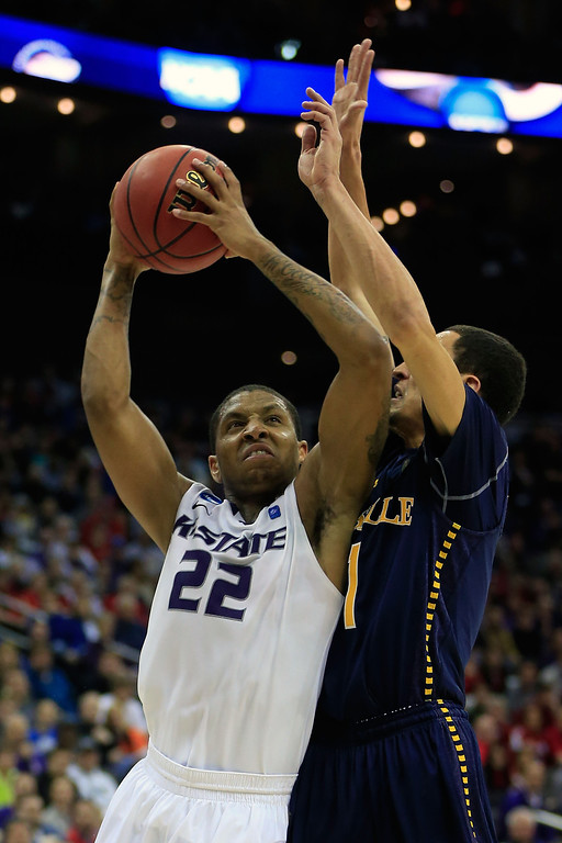. KANSAS CITY, MO - MARCH 22: Rodney McGruder #22 of the Kansas State Wildcats shoots against D.J. Peterson #1 of the La Salle Explorers in the second half during the second round of the 2013 NCAA Men\'s Basketball Tournament at the Sprint Center on March 22, 2013 in Kansas City, Missouri.  La Salle won 63-61. (Photo by Jamie Squire/Getty Images)