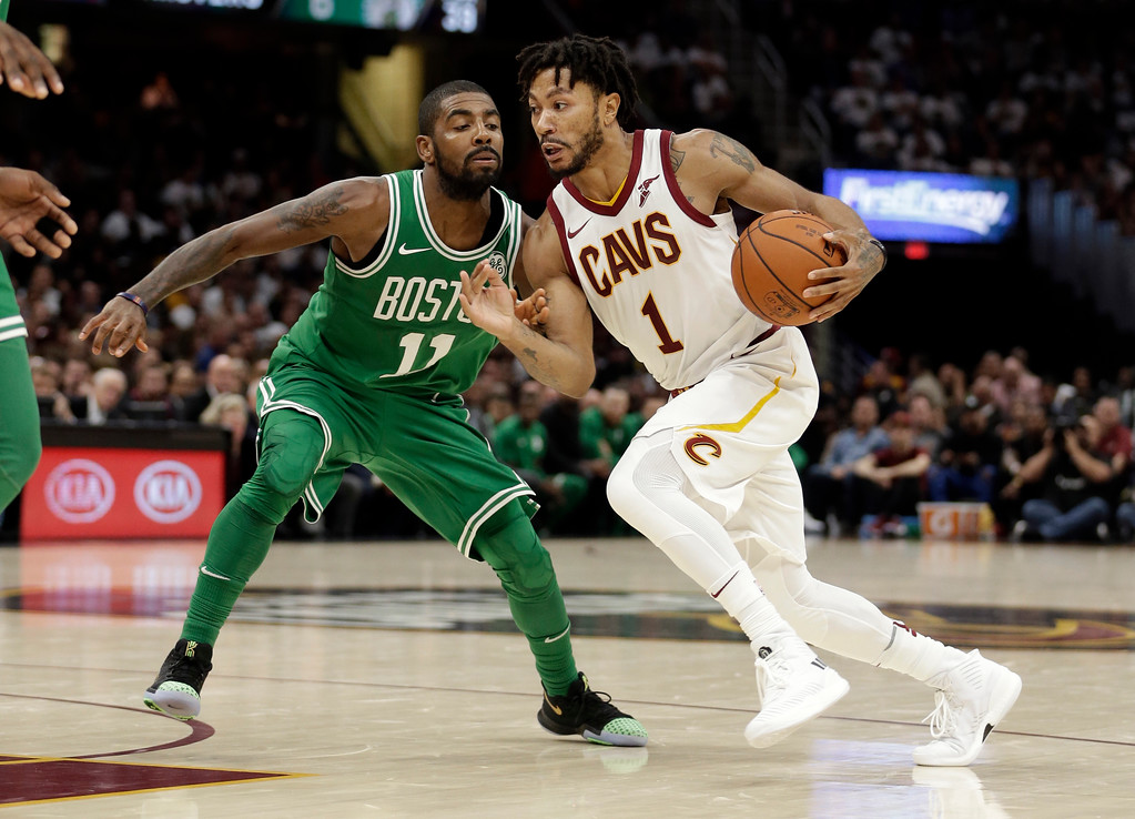 . Cleveland Cavaliers\' Derrick Rose (1) drives past Boston Celtics\' Kyrie Irving (11) in the second half of an NBA basketball game, Tuesday, Oct. 17, 2017, in Cleveland. The Cavaliers won 102-99. (AP Photo/Tony Dejak)