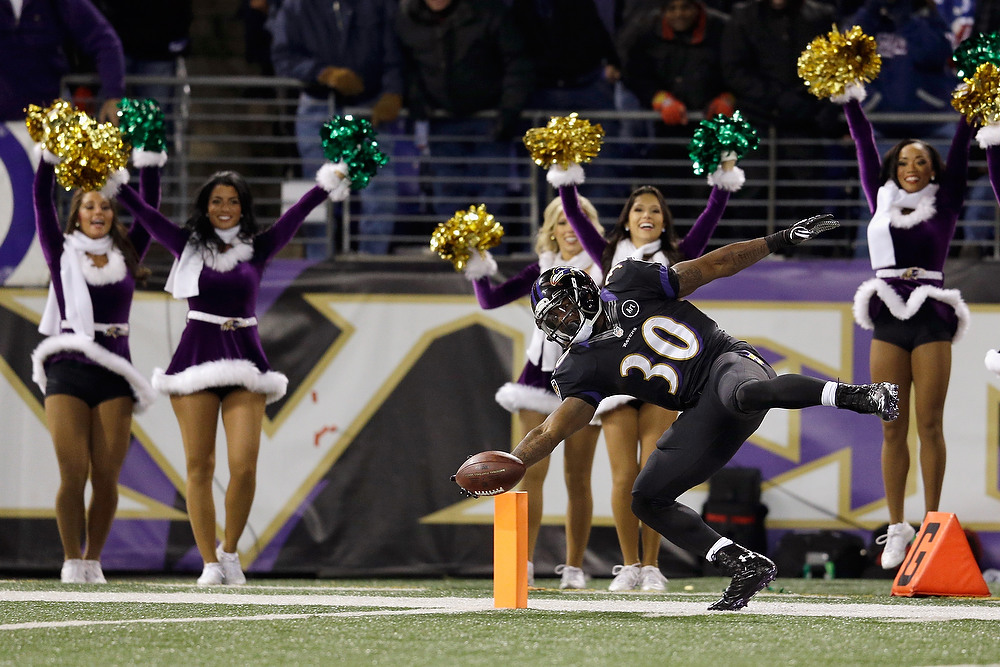 . Running back Bernard Pierce #30 of the Baltimore Ravens falls out of bounds after a long run during the second half against the New York Giants at M&T Bank Stadium on December 23, 2012 in Baltimore, Maryland.  (Photo by Rob Carr/Getty Images)