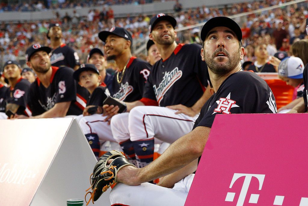. American League, Boston Red Sox pitcher Justin Verlander, right, watches play during the MLB Home Run Derby, at Nationals Park, Monday, July 16, 2018 in Washington. The 89th MLB baseball All-Star Game will be played Tuesday. (AP Photo/Patrick Semansky)