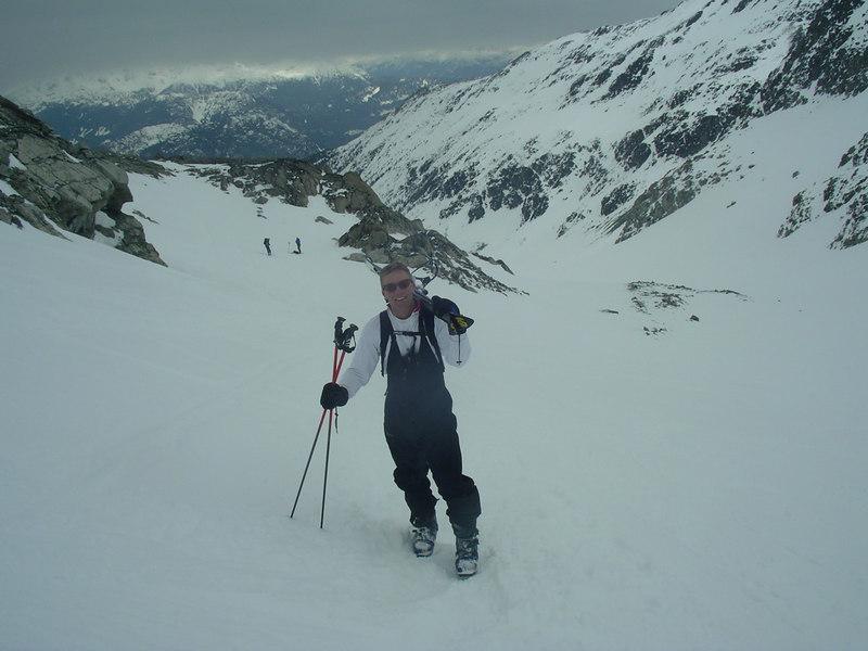Phil follows behind, the Blackcomb glacier below him.