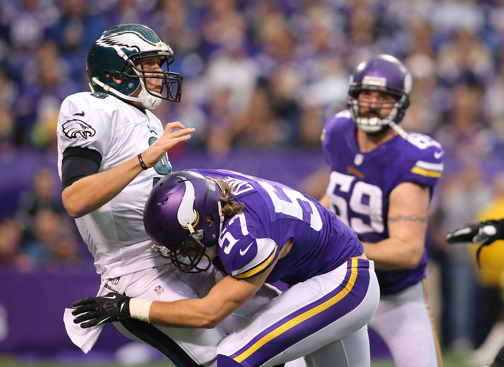 . Nick Foles #9 of the Philadelphia Eagles passes the ball while Audie Cole #57 of the Minnesota Vikings applies pressure on December 15, 2013 at Mall of America Field at the Hubert H. Humphrey Metrodome in Minneapolis, Minnesota. (Photo by Adam Bettcher/Getty Images)
