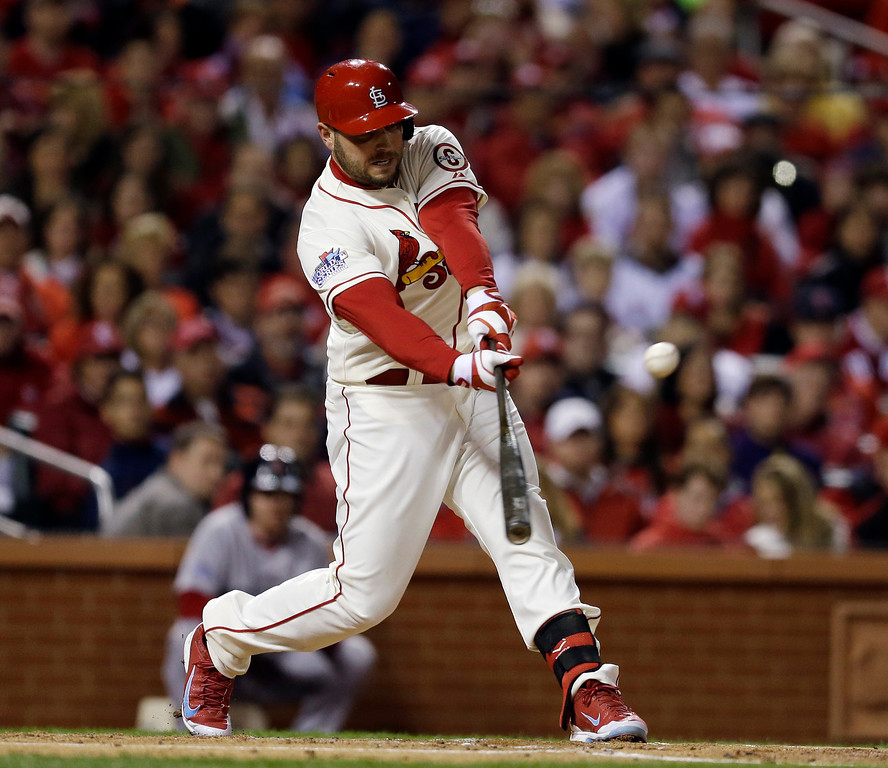 . St. Louis Cardinals\' Matt Holliday hits an RBI single during the first inning of Game 3 of baseball\'s World Series against the Boston Red Sox Saturday, Oct. 26, 2013, in St. Louis. (AP Photo/Jeff Roberson)