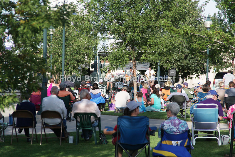 Havre Daily News / Floyd Brandt  Town Square Park filled with people listening to the music of Swamp Goat performing for Sounds on the Square Wednesday