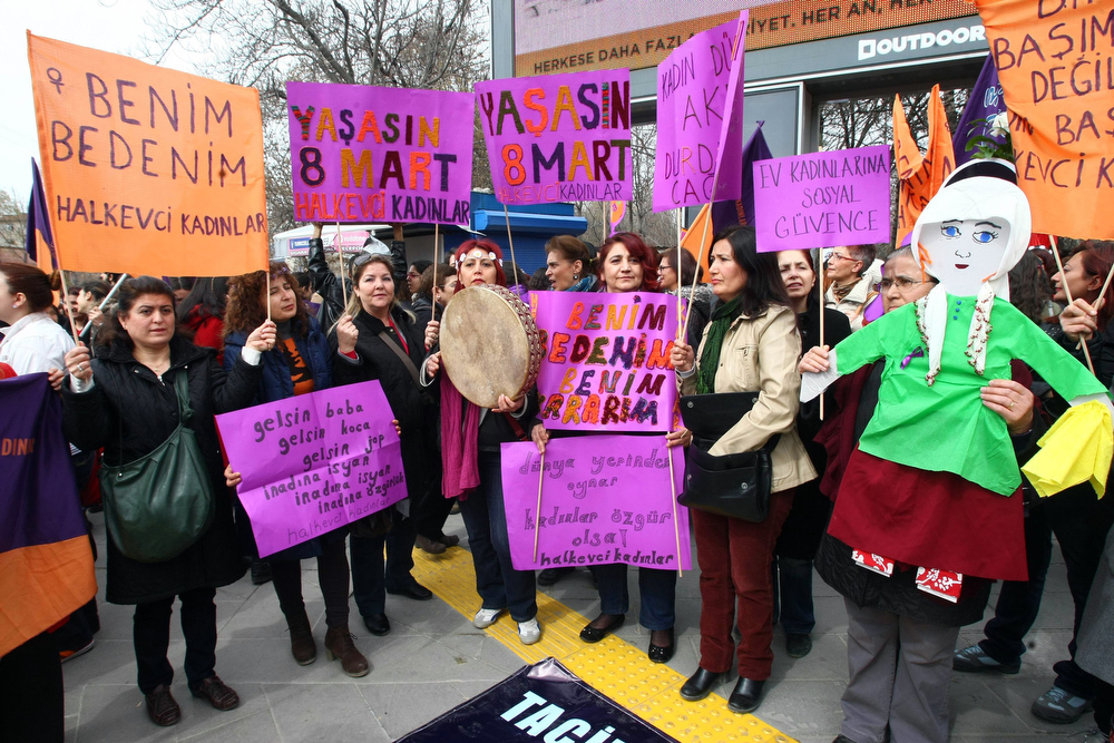 """. Women hold placards including one reading \""""Don\'t touch my body\"""" as they march to commemorate the International Women\'s Day on March 8, 2013 in Ankara. Hundreds of demonstrators took part in the rally calling to stop violence towards women.   ADEM ALTAN/AFP/Getty Images"""
