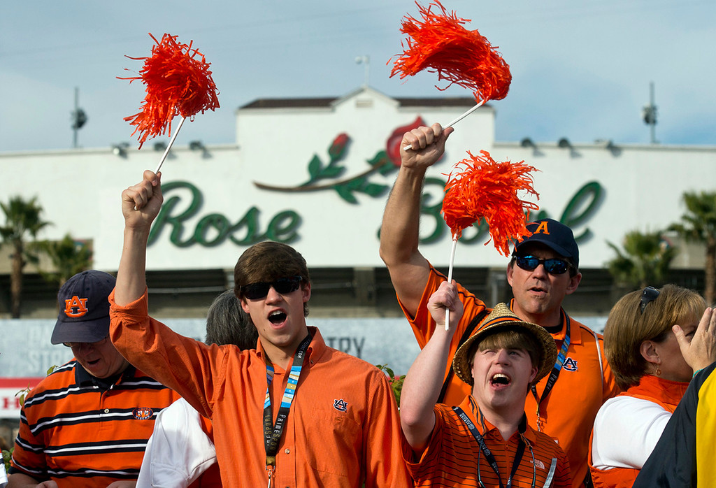. Auburn fans cheer before the BCS National Championship game at the Rose Bowl in Pasadena Calif. on Monday, Jan. 6, 2014. (Watchara Phomicinda/ Pasadena Star-News)