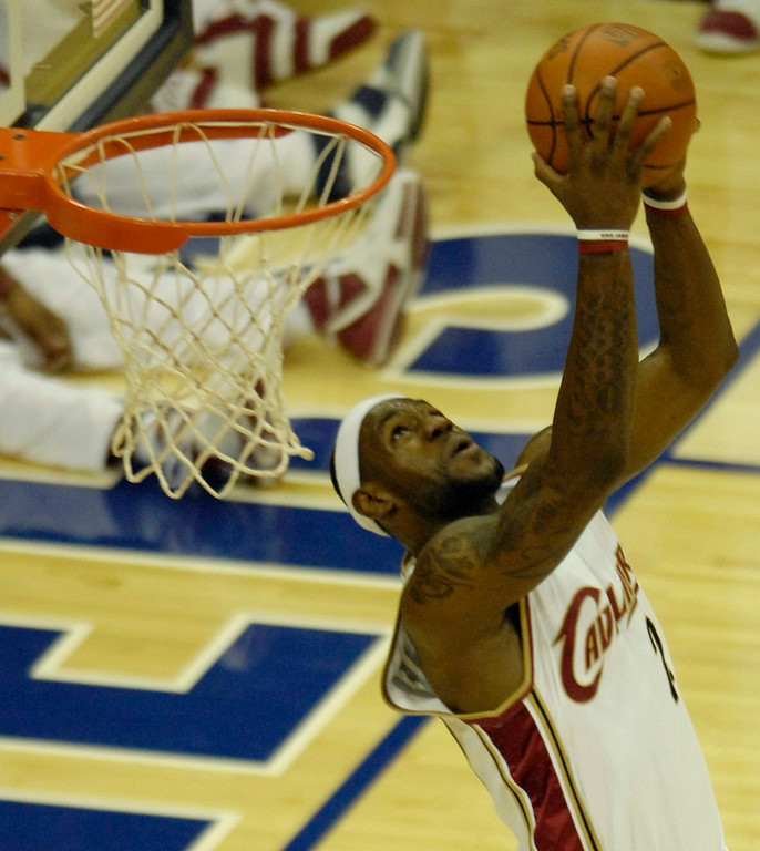. Michael Blair/MBlair@News-Herald.com LeBron James goes up for a reverse dunk versus the Pistons Thursday at The Q.