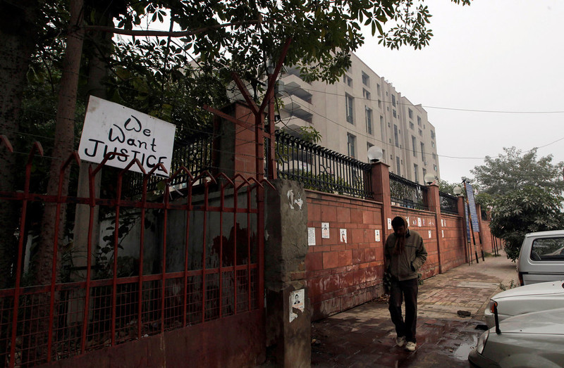 . A placard hangs on a fence of the District Court complex where a new fast-track court was inaugurated Wednesday to deal specifically with crimes against women in New Delhi, India, Thursday, Jan. 3, 2013. Indian police were preparing Thursday to file rape and murder charges against a group of men accused of sexually assaulting a 23-year-old university student for hours on a moving bus in New Delhi. The Dec. 16 attack on the woman, who later died of her injuries, has caused outrage across India, sparking protests and demands for tough new rape laws, better police protection for women and a sustained campaign to change society\'s views about women. (AP Photo/ Manish Swarup)