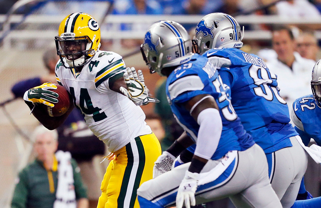 . Green Bay Packers running back James Starks (44) is chased by Detroit Lions linebacker Tahir Whitehead (59) and defensive end George Johnson (93) during the first half of an NFL football game in Detroit, Sunday, Sept. 21, 2014. (AP Photo/Rick Osentoski)