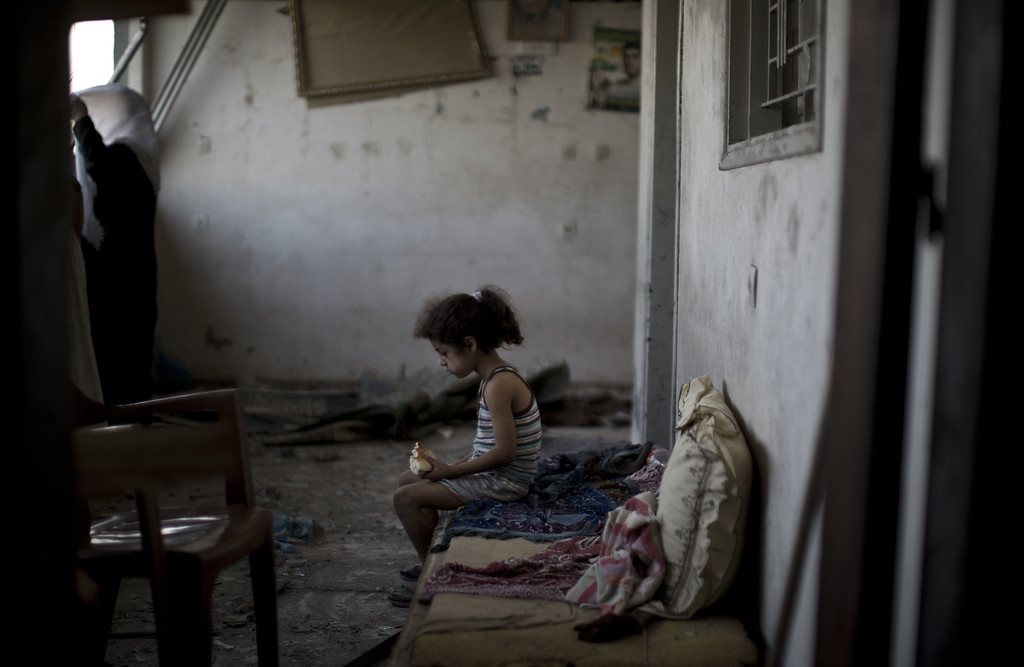 . A Palestinian girl sits and eats in the rubble of her destroyed home, on August 2, 2014 following an overnight Israeli strike on Gaza City. A  fresh wave of violence killed dozens in Gaza after the collapse of a UN and US backed ceasefire, officials said, as Hamas denied it kidnapped an Israeli soldier. AFP PHOTO / MAHMUD HAMS/AFP/Getty Images