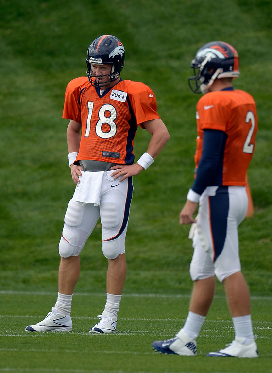 . Denver Broncos quarterback Peyton Manning (18) looks on watching drills during practice September 19, 2013 at Dove Valley. (Photo by John Leyba/The Denver Post)
