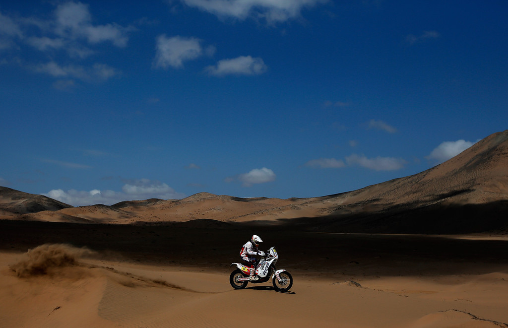 . EL SALVADOR, CHILE - JANUARY 17:  (#15) Kuba Przygonski of Poland for KTM Orlen Rally Factory Team competes in stage 12 on the way to La Serena during Day 13 of the 2014 Dakar Rally on January 17, 2014 in El Salvador, Chile.  (Photo by Dean Mouhtaropoulos/Getty Images)