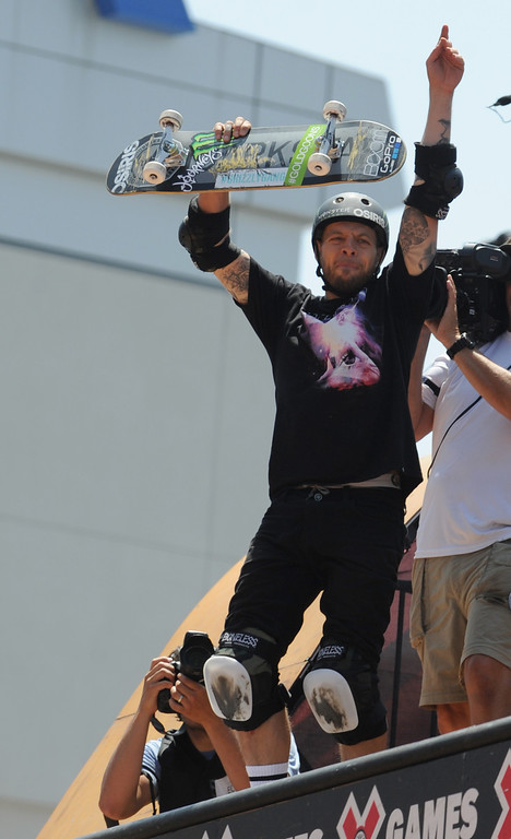 . Pierre-Luc Gagnon celebrates a ride that captured a 2nd place during the Skateboard Vert Finals at L.A. Live in Los Angeles, CA. 8/3/2013(John McCoy/LA Daily News)