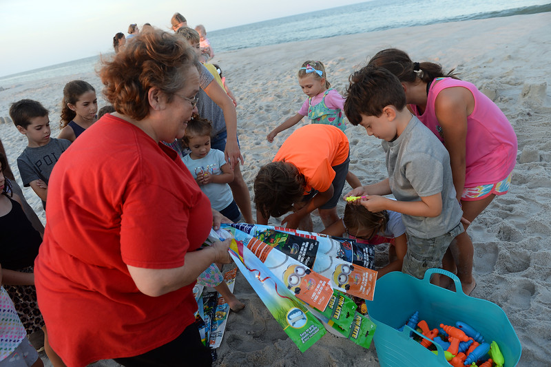 Jackie O'Leary hands out gifts to the attendees at the Kites and Castles Event on Lavallette B, in Lavallette. NJ on 08/01/2019.