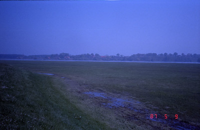 Another view across the Elbe river into the DDR.  A collection of houses and buildings of a farm village.