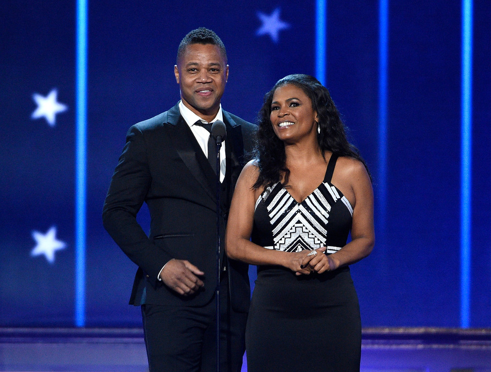 . Cuba Gooding Jr., left, and Nia Long present the award for best actor in a comedy at the 22nd annual Critics\' Choice Awards at the Barker Hangar on Sunday, Dec. 11, 2016, in Santa Monica, Calif. (Photo by Chris Pizzello/Invision/AP)