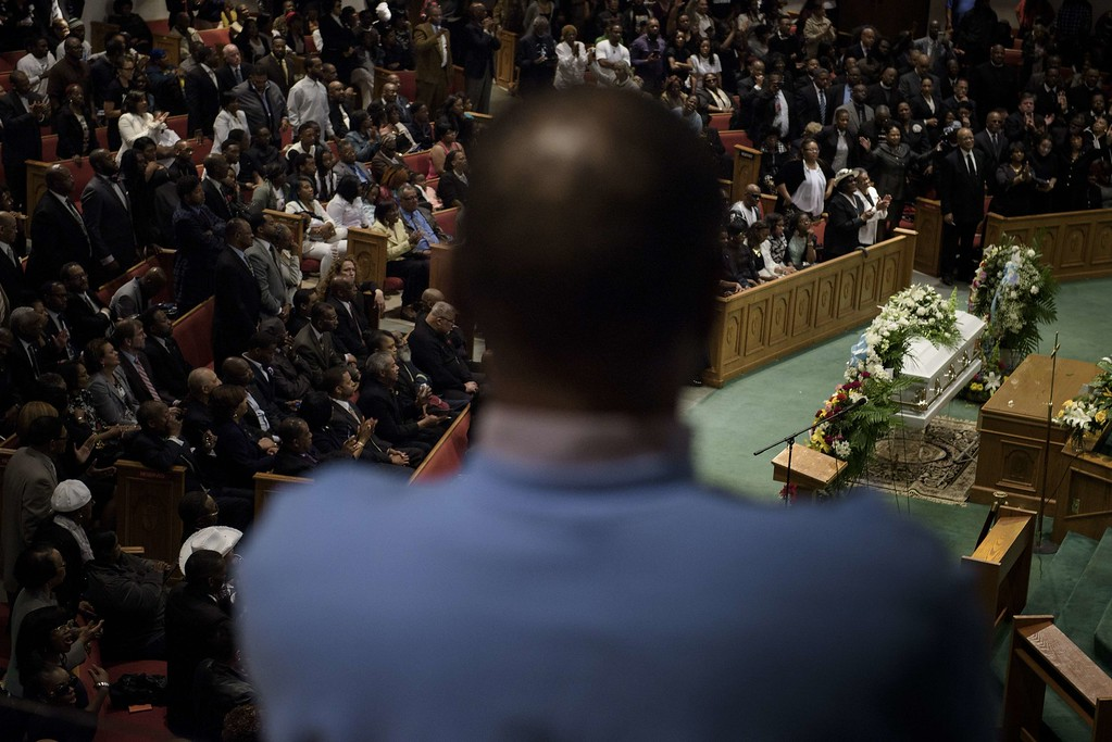 . People listen during Freddie Gray\'s funeral at New Shiloh Baptist Church April 27, 2015 in Baltimore, Maryland.  Mourners gathered in large numbers at the funeral of Gray, the 25-year-old black man who died April 19 after an encounter April 12 with police left him with grave spinal injuries. BRENDAN SMIALOWSKI/AFP/Getty Images