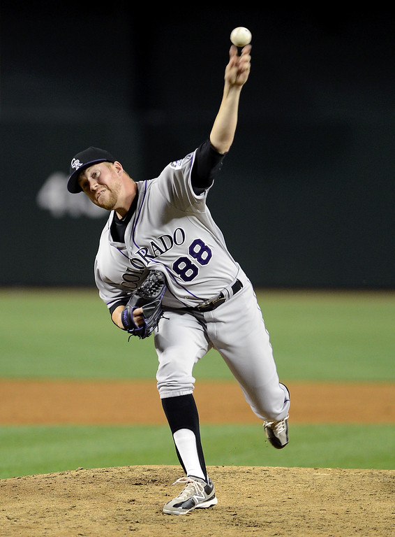 . PHOENIX, AZ - APRIL 26:  Reliever Josh Outman #88 of the Colorado Rockies pitches against the Arizona Diamondbacks in the sixth inning at Chase Field on April 26, 2013 in Phoenix, Arizona.  (Photo by Jennifer Stewart/Getty Images)