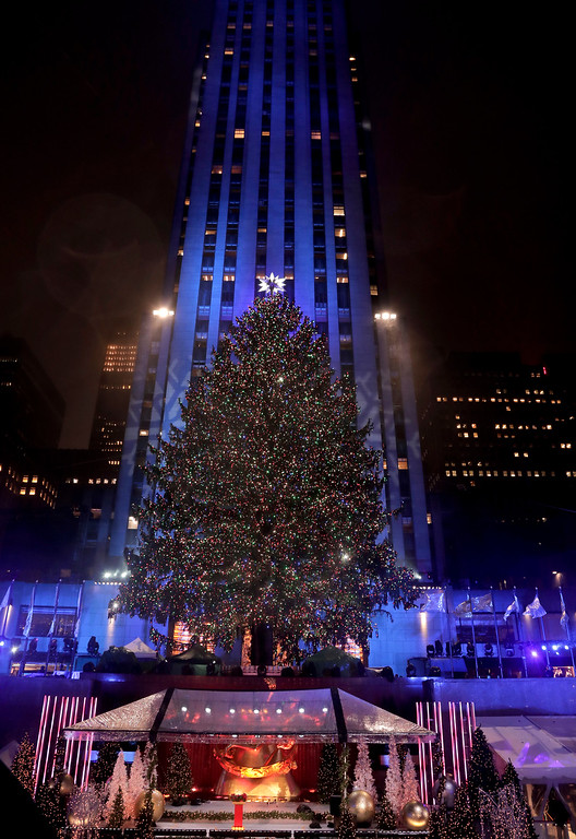 . The Rockefeller Center Christmas tree stands lit at Rockefeller Center during the 84th annual Rockefeller Center Christmas tree lighting ceremony, Wednesday, Nov. 30, 2016, in New York. The 94-foot Norway spruce is covered with more than 50,000 multi-colored LED lights. (AP Photo/Julie Jacobson)