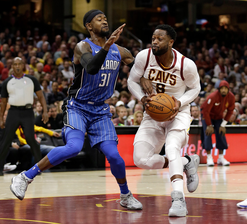 . Cleveland Cavaliers\' Dwyane Wade, right, drives past Orlando Magic\'s Terrence Ross (31) in the first half of an NBA basketball game, Saturday, Oct. 21, 2017, in Cleveland. (AP Photo/Tony Dejak)