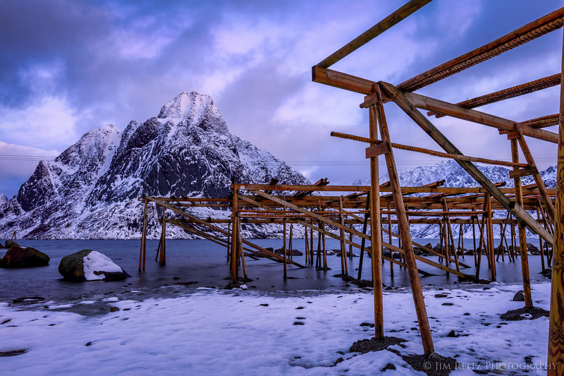 "Fish-drying racks in Reine, Lofoten, Norway. They produce ""stockfish"", which is air-dried (not salt-cured) cod. Fish are hung on the racks between Feb. and June (we were a bit early) to dry."