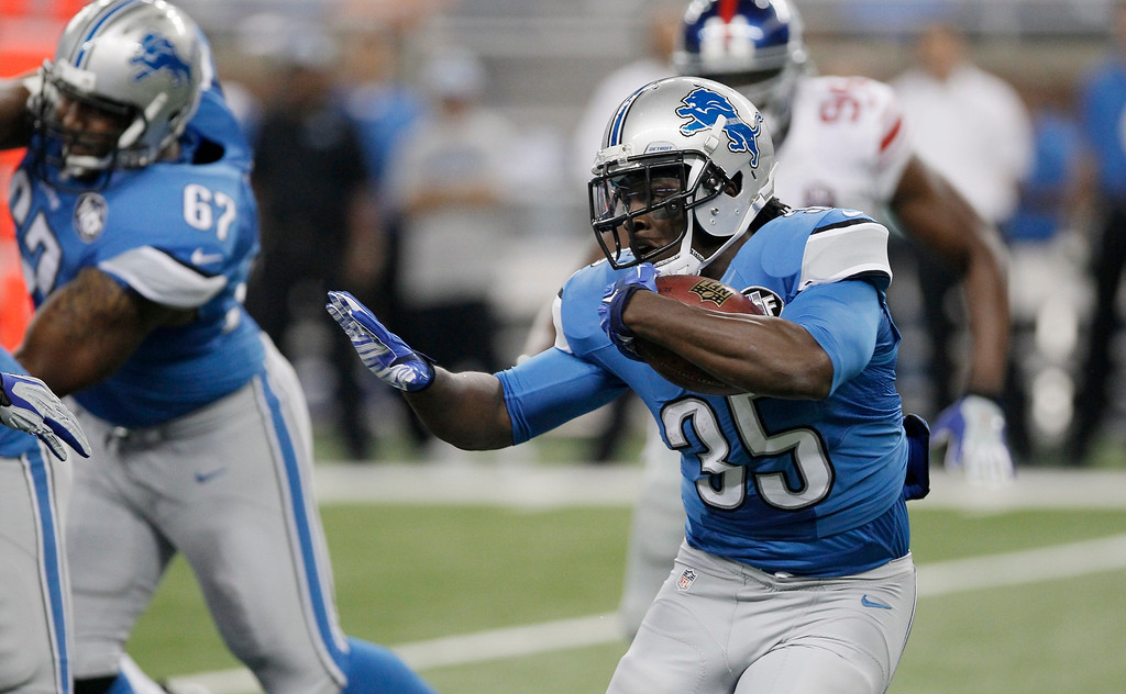 . Detroit Lions running back Joique Bell runs against the New York Giants defense during the first quarter of an NFL football game in Detroit, Monday, Sept. 8, 2014. (AP Photo/Duane Burleson)