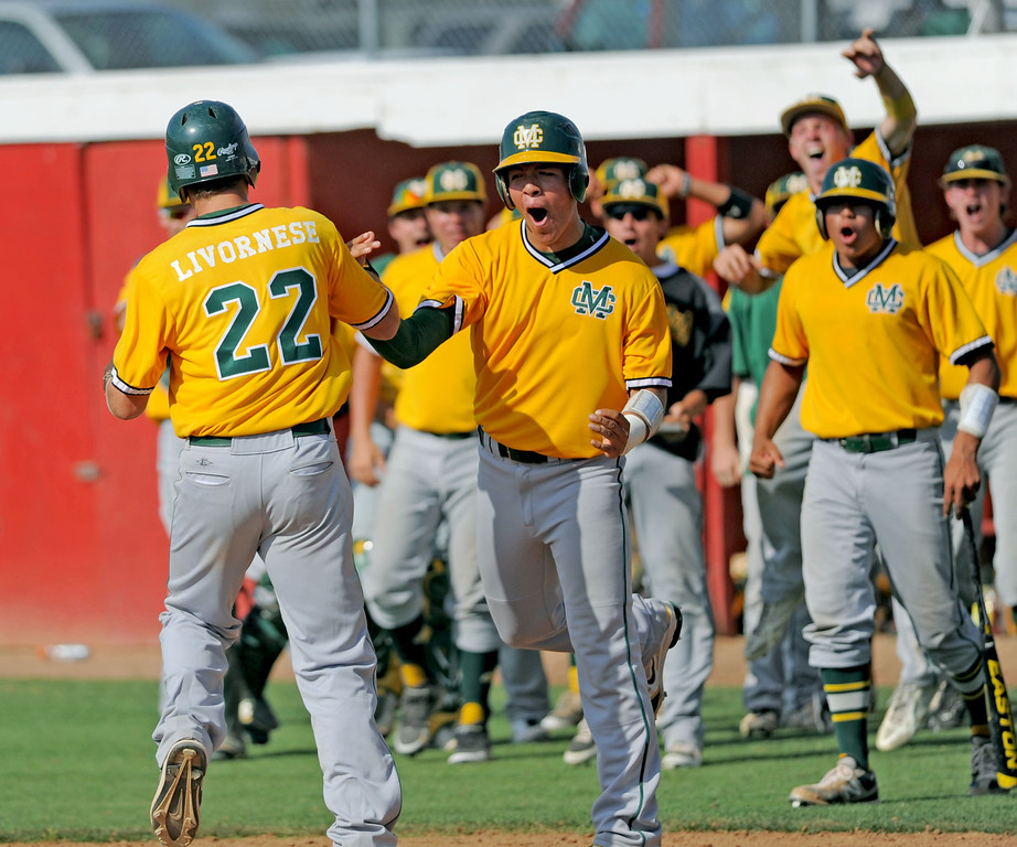 . 05-28-2013-( Sean Hiller/LANG) Mira Costa beat Elsinore 5-3 in Tuesday\'s CIF Southern Section Division III semifinal at Elsinore High School. Costa\'s Grant Livornese is swarmed after hitting the game winning home run in the 7th inning.