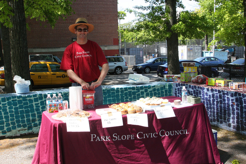Ken Freeman, President of the Park Slope Civic Council, 'manning' the bake sale!
