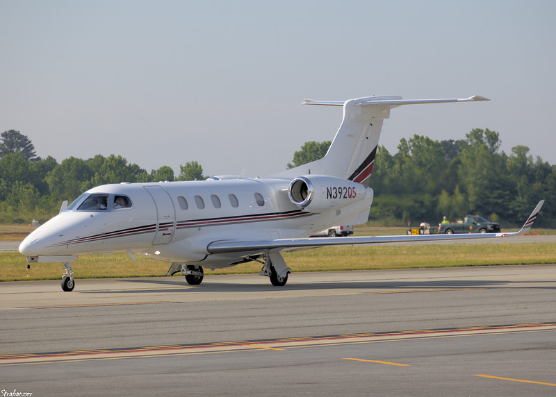 Embraer EMB-505 Phenom 300   c/n 50500349  N392QS of Netjets Taxiing out for a flight to Louisiana Regional (KREG) KPDK, Dekalb GA, 05/28/2021, This work is licensed under a Creative Commons Attribution- NonCommercial 4.0 International License.