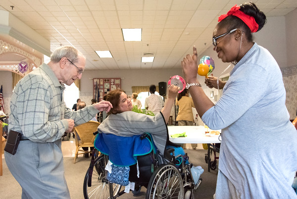 05/15/18 Wesley Bunnell | Staff Singer Kate Stone entertained the residents of Autumn Lake Healthcare in New Britain during Happy Hour on Wednesday May 15th. Sebby Lanza, L, whose wife is a resident of the facility dances with resident Shauntel Brown as Stone performs.