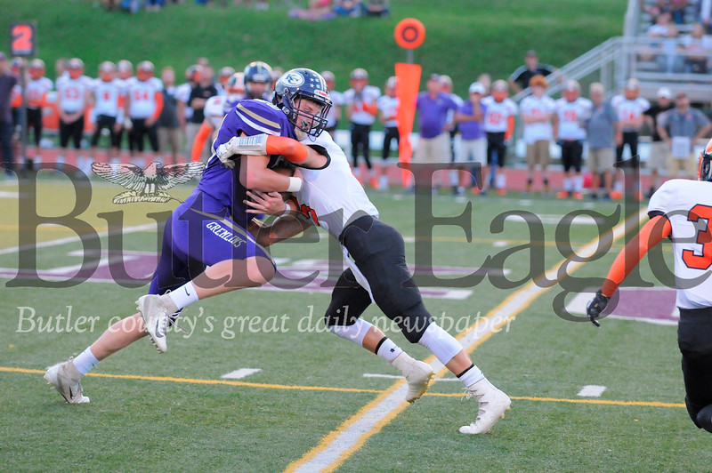 Karns City #88 Nathan Waltman tries to past Clarion #5 Archer Miller during a game at Karns City Stadium on Friday September 7, 2018. (Jason Swanson photo)