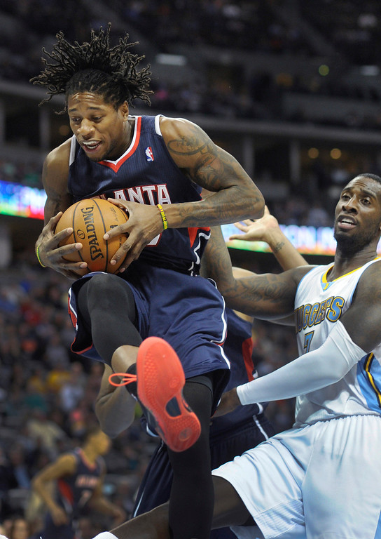 . Atlanta forward Cartier Martin grabbed a rebound in front of Nuggets forward J.J. Hickson in the first half. The Denver Nuggets hosted the Atlanta Hawks at the Pepsi Center Thursday night, November 7, 2013. Photo By Karl Gehring/The Denver Post