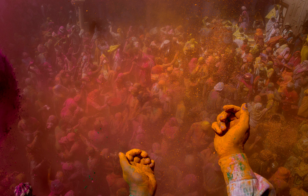 . Locals and Indian Hindu widows throw flower petals and colored powder during Holi celebrations at the Gopinath temple in Vrindavan, 180 kilometres (112 miles) south-east of New Delhi, India, Thursday, March 9, 2017. A few years ago this joyful celebration was forbidden for Hindu widows. Like hundreds of thousands of observant Hindu women they would have been expected to live out their days in quiet worship, dressed only in white, their very presence being considered inauspicious for all religious festivities. (AP Photo /Manish Swarup)