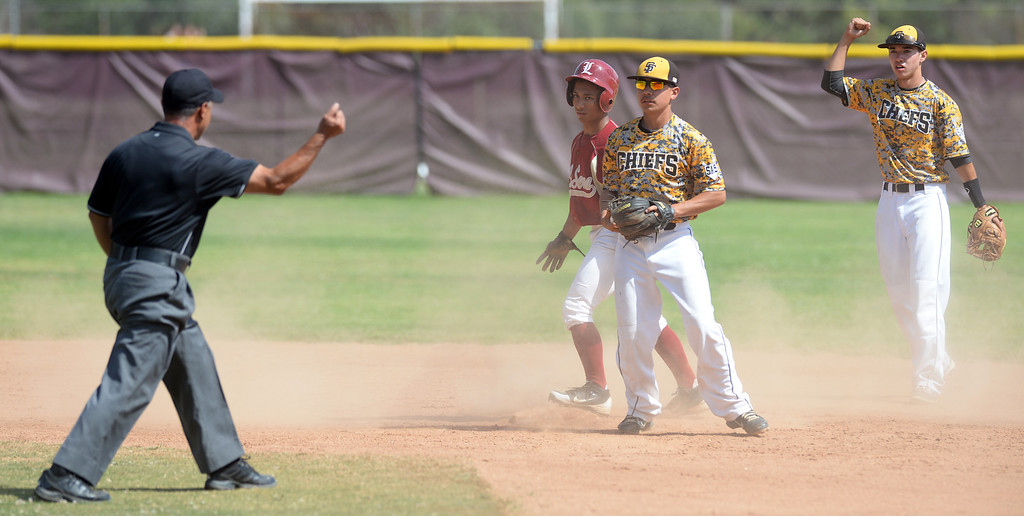 . Santa Fe second baseman Andrew Espanoza (#29) tags out La Serna Ruben Rios (#1) trying to steal second base in their Del Rio League game at La Serna High School in Whittier on Wednesday April 23, 2014. (Staff Photo by Keith Durflinger/Whittier Daily News)