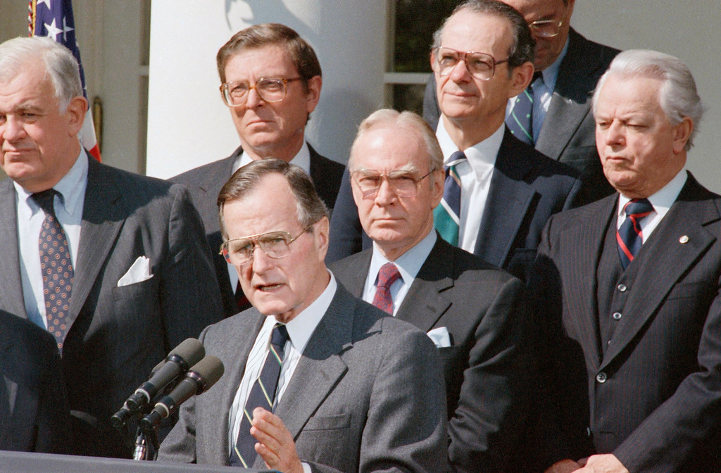 . President  George H.W. Bush, with congressional leaders behind him, announces a tentative agreement on a nearly $30 billion deficit-reduction plan on April 14, 1989 in Washington.     Behind Bush are Senator Pete Domenici, R-N.M., left; House Speaker Jim Wright, center; and Rep. Bill Frenzel, R-Minn. (AP Photo/Charles Tasnadi)