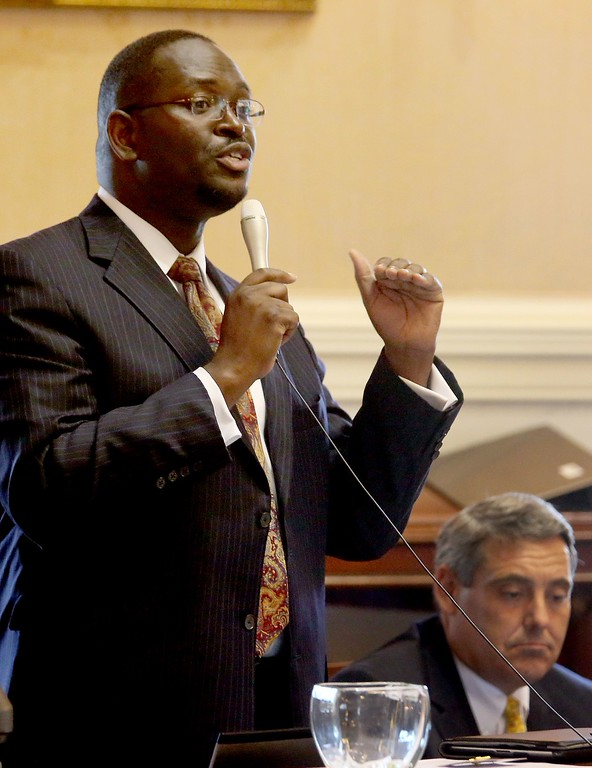 . In this June 3, 2014 photo, state Sen. Clementa Pinckney speaks at the South Carolina Statehouse in Columbia, S.C. Pinckney was killed, Wednesday, June 17, 2015, in a shooting at an historic black church in Charleston, S.C. The shooter is still at large. (Grace Beahm/The Post and Courier via AP)