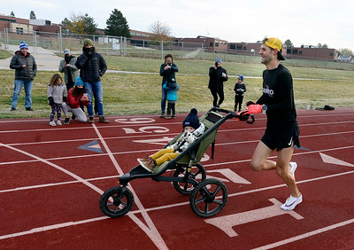 Photos: Vos Breaks Mile Record While Running With a Stroller
