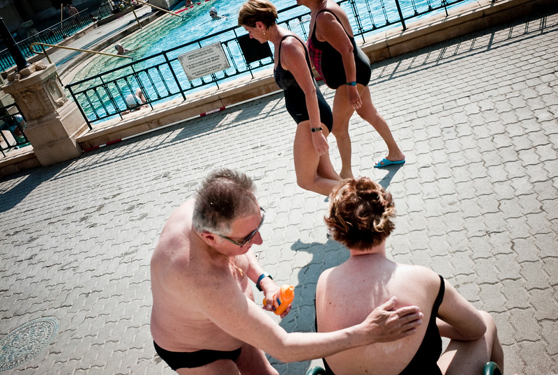March , 2012, Budapest, Hungary -  Locals spend their afternoon, seen at  Szechenyi Bath.   Budapest is known as the SPA Capital of the world.  Nearly 120 hot springs feed the city's historic thermal baths (Furdo) and approximately 70 million litres of water used every day. The water full of minerals is supposed to cure many illness.