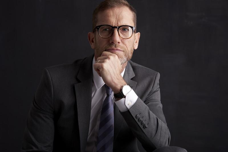Overwhelmed professional man portrait