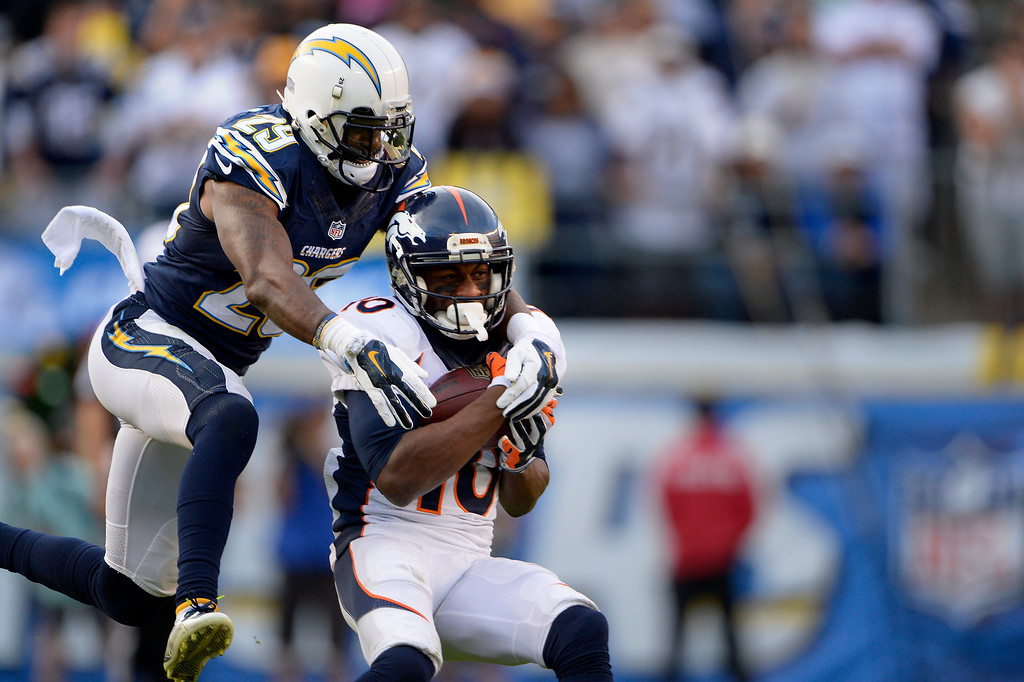 . SAN DIEGO, CA. December 14, - wide receiver Emmanuel Sanders #10 of the Denver Broncos makes a catch in front of cornerback Brandon Flowers #26 of the San Diego Chargers at Qualcomm Stadium December 14, 2014 San Diego, CA (Photo By Joe Amon/The Denver Post)