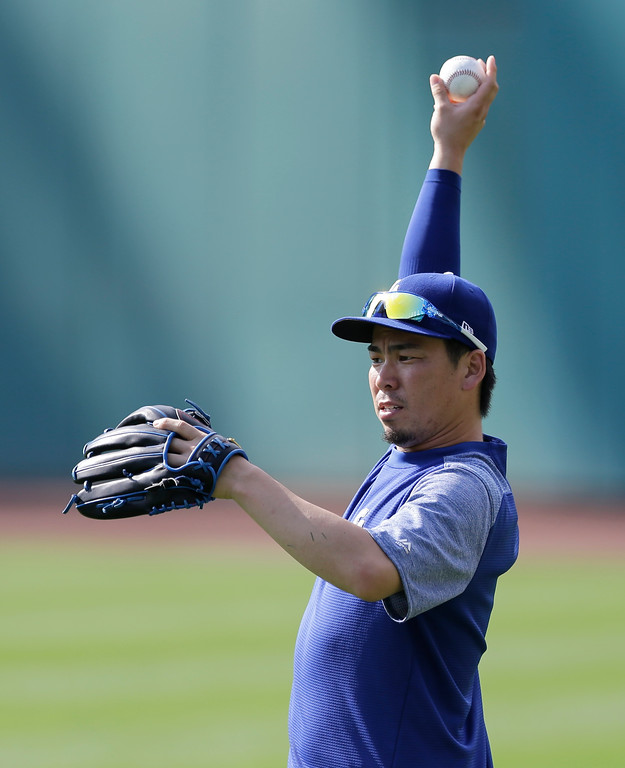 . Los Angeles Dodgers starting pitcher Kenta Maeda warms up before an interleague baseball game between the Los Angeles Dodgers and the Cleveland Indians, Tuesday, June 13, 2017, in Cleveland. (AP Photo/Tony Dejak)