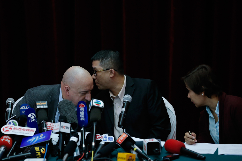 . Hugh Dunleavy (L) and Ignatius Ong (C) from Malaysia Airline attend a press conference on March 9, 2014 in Beijing, China. Malaysia Airlines Flight MH370 from Kuala Lumpur to Beijing and carrying 239 onboard was reported missing.  (Photo by Lintao Zhang/Getty Images)