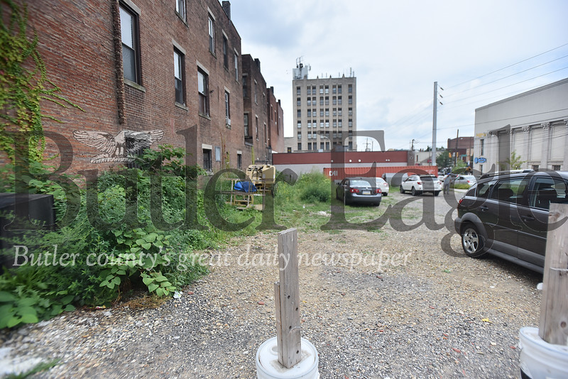 97486 The lot behind Butler Brew Works needs cleaned up