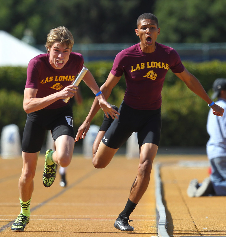 . Las Lomas\' Connor Speck takes the baton from teammate Jack Kane in the boys 4x400 meter relay final at the North Coast Section Meet of Champions at Cal\'s Edwards Stadium in Berkeley, Calif., on Saturday, May 25, 2013. Las Lomas placed seventh. (Anda Chu/Bay Area News Group)