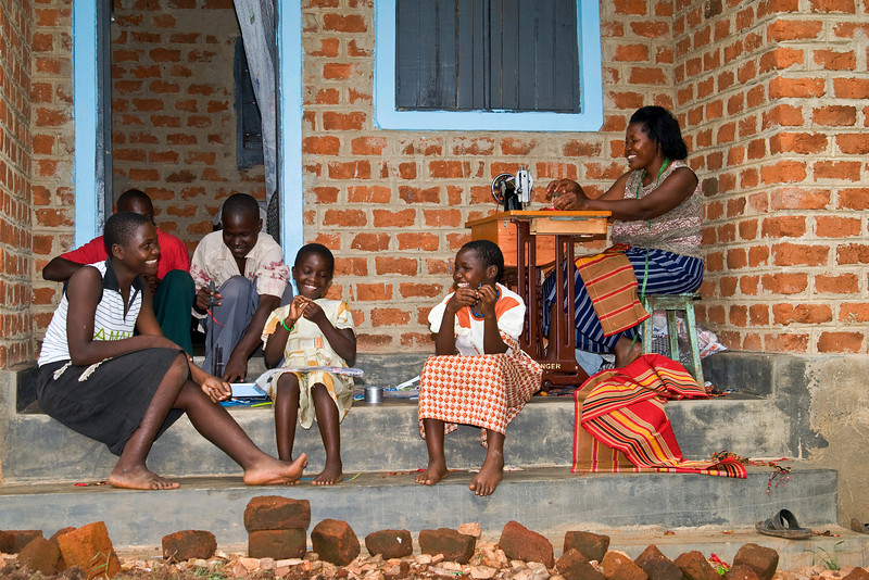 a woman, and her family, who has finished the bead for life program and started a tailoring business