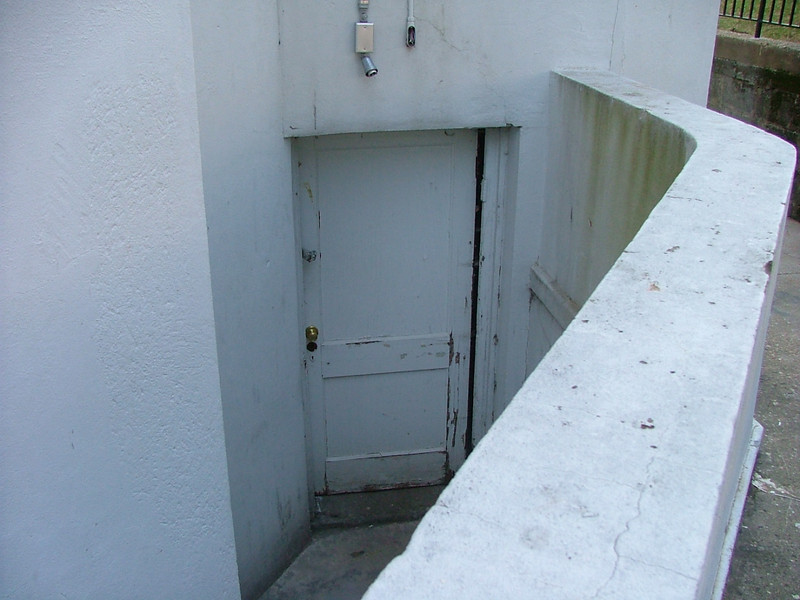 Back entrance to corner cupboard ne