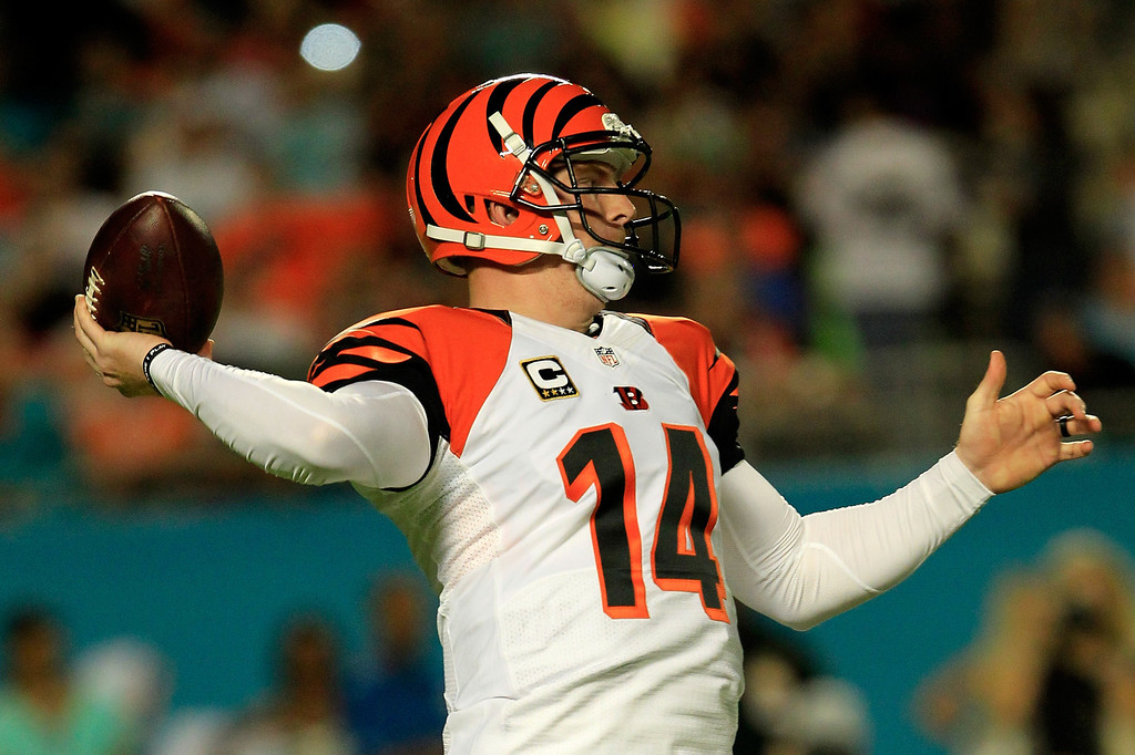 . MIAMI GARDENS, FL - OCTOBER 31: Andy Dalton #14 of the Cincinnati Bengals attempts to pass the ball against the Miami Dolphins at Sun Life Stadium on October 31, 2013 in Miami Gardens, Florida. (Photo by Chris Trotman/Getty Images)