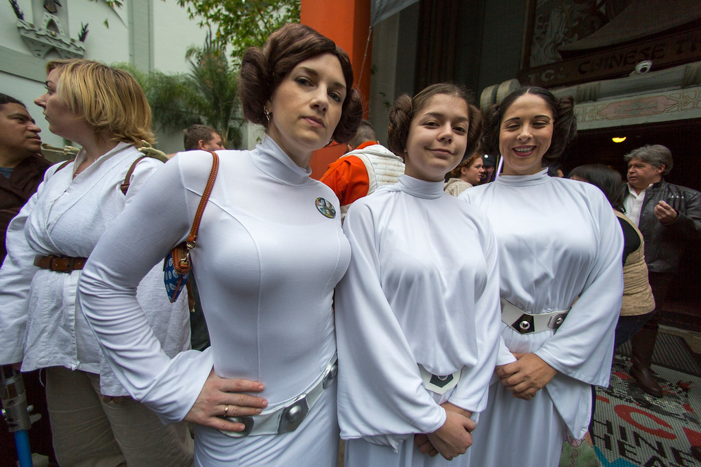 ". Costumed fans dressed as Princess Leia, in honor of actress Carrie Fisher, who played Leia in the ""Star Wars\"" movie series, gather for a memorial for actress Carrie Fisher in the forecourt at the TCL Chinese Theatre in the Hollywood section of Los Angeles, Saturday, Dec. 31, 2016. Fisher had been hospitalized since Dec. 23 after falling ill aboard a flight and being treated by paramedics at the Los Angeles airport. One day after Fisher\'s death, her mother actress, 84-year-old Debbie Reynolds, died as well. A joint funeral for the two women has been announced. (AP Photo/Damian Dovarganes)"